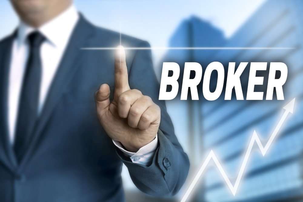 Broker touchscreen is operated by businessman.